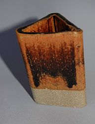 """Raw Sienna  Wollastonite – 28 Ferro Frit #3195 - 23 Nepheline Syenite – 4 EPK – 28 Silica – 17 Red Iron Oxide – 6 Rutile – 6 From John Hesselberth and Ron Roy's """"Mastering Cone Six Glazes"""" Sensitive to application thickness and temperature. This glaze will run if thick."""