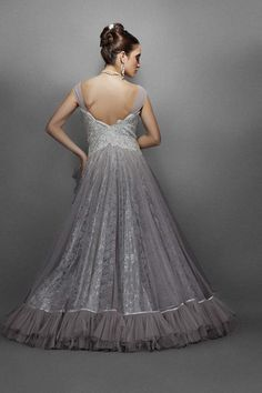 Grey-silver gown encrusted with silver zircons in a fitted bodice with off shoulder pleated net straps. A delicate lace & net flair with pleated net trim in the top net layer hemline cascading from th Net Gowns, Ball Gowns, Silver Gown, Party Gowns, Princess Party, Fitted Bodice, Formal Dresses, Wedding Dresses, Pretty Dresses