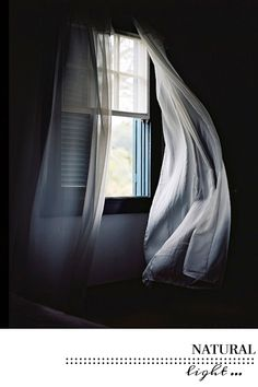 linen curtains blowing in the breeze