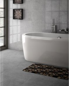 Quarz's unique look is inspired by the beauty of natural stone and its wide diversity of textures and colors; these are reinterpreted and brought to all living spaces on a variety of formats and finishes. Large Floor Tiles, Wall And Floor Tiles, Concrete Look Tile, Luxury Sale, Wall Tiles Design, Tile Trim, Stone Tiles, Natural Stones, Living Spaces