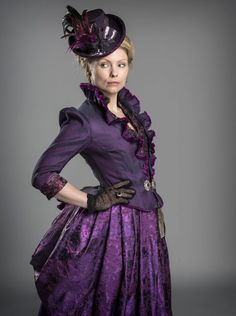 Purple Victorian Dress (costume from BBC's 'Ripper Street') - Purple jacket, bodice, skirt, and hat. Black fishnet gloves. - For costume tutorials, clothing guide, fashion inspiration photo gallery, calendar of Steampunk events, & more, visit SteampunkFashionGuide.com