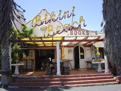 Bikini Beach Books, on the beach road in Gordons Bay. A special bookshop - a favourite place for many local bibliophiles to spend some time between thousands of books. Beach Road, Table Mountain, Cool Books, Bookstores, Coastal Homes, Store Fronts, Bikini Beach, Bay Area, South Africa