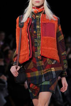Tommy Hilfiger at New York Fall 2014 RTW. I'm in LOVE with the textures and patterns and gorgeous colors and layering of fabrics in this collection. It's so fun and it's kind of like a new spin on grunge.