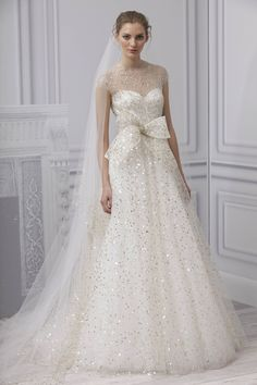 Monique Lhuillier's new spring collection showcases her passion for lace, and beauty; making each bride feel like a princess as they step into one of her lavishing gowns.