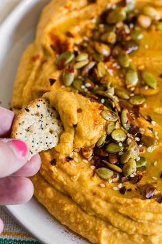 This super simple semi-homemade easy pumpkin hummus is the perfect addition to your party or snack routine. It all starts with plain hummus that is dressed up with pumpkin, maple syrup, and smoked paprika. Pumpkin Hummus, Roasted Pumpkin Seeds, Pumpkin Puree, What Is Hummus, Semi Homemade, Holiday Appetizers, Night Snacks, Seasonal Food, Smoked Paprika