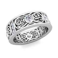 Celtic Knot Diamond Wedding Band Ring for Men in Platinum, 7.5mm. This stunning Celtic wedding band features Celtic knots interspersed with bezel set diamonds and sparkling round cut diamonds in platinum band.