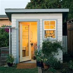 This tiny home office, housed in a converted potting shed is the perfect place to steal away from domestic responsibilities and focus on work. Converted shed office, outdoor office, backyard office. Window air unit and I'm set! Outdoor Office, Backyard Office, Backyard Studio, Backyard Retreat, Garden Office, Outdoor Living, Outdoor Retreat, Tiny Home Office, Shed Office