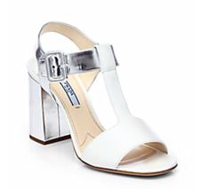 White sandal with metallic heel.