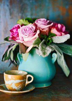 Roses in aqua vase