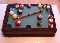 Pool table groom's cake.  Fondant balls and cue stick.  Fondant green top.  Buttercream for the rest of the cake.