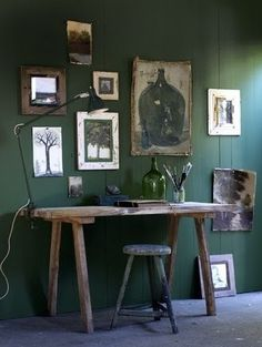 Green gallery wall and rustic desk.