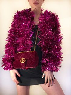 Stand out in our pink tinsel jacket. Available in sizes: Small (8-10) Medium (10-12) and Large (14-16) Jacket is itch proof with a fabric inner lining and cuffed sleeves.