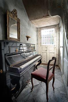 old vintage and antique piano, urban exploration and decay. Abandoned house interior and staircase. Urbex Belgium