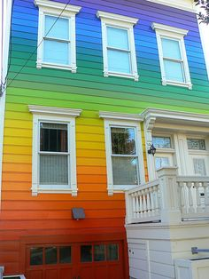 Home Colorful Home. I would go with a neutral landscape to keep the focus on my rainbow house!