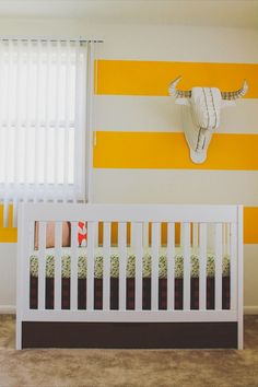 Lumberjack & woodlands inspired yellow boys nursery.  #yellow #nursery #stripewall