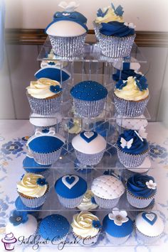 Royal blue, white & silver wedding anniversary cupcakes.......