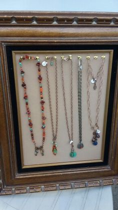 Necklaces on frame. Beaded, copper leaf, embossed charm, pirate coin necklace & charm necklace