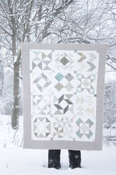 half square triangle quilt in the snow