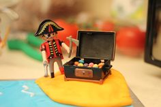 Detail from pirate cake. Fondant icing island with Playmobile pirate and treasure chest filled with mini-smarties.
