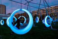 Höweler + Yoon Architecture have created an interactive playscape composed of 20 illuminated ring-shaped swings.