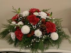 A cute red and white arrangement, sprinkles with babies breath.