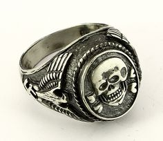 """The SS-Ehrenring (""""SS Honour Ring""""), unofficially called Totenkopfring (""""Skull Ring""""), was an award of Heinrich Himmler's Schutzstaffel (SS). It was not a state decoration, but rather a personal gift bestowed by Himmler.  How can I not use this in a book with a paranormal Nazi after our hero and heroine?"""