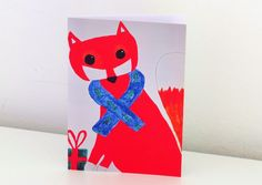 Fox Card - This Stylish, Fun Fox is Ready to give his Present with a Blue Scarf with Trees & a Green and Red Present  by his Paws :). £2.50, via Etsy.
