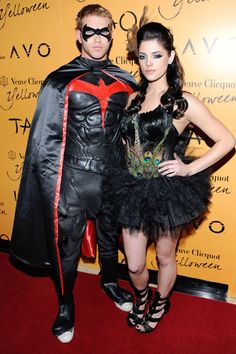 Kellan Lutz and Ashley Greene arrive at Veuve Clicquot's Yelloween at Tao Nightclub at the Venetian Resort Hotel Casino on October 31, 2009 in Las Vegas, Nevada, dressed as Robin from Batman and a peacock (respectively).    - ELLE.com