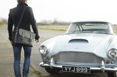 Discover the British made Marton Messenger bag alongside the Aston Martin DB4 at www.acassi.co.uk   Made from Leather and Harris Tweed.