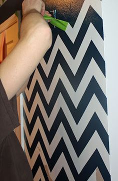 How to paint chervron stripes on a wall! I totally want to do this ...