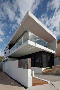 Located on the sloping northern flank of the Bronte gully. The site has views over the adjacent park towards the beach and the ocean baths.   The idea for the house was generated by inverting the typical planning arrangement – the living areas have been located on the upper floor with the bedrooms on the lower floor. Thus the living spaces capture the view and the natural light while the sleeping spaces benefit from the additional privacy at the ground level. #MHNDU