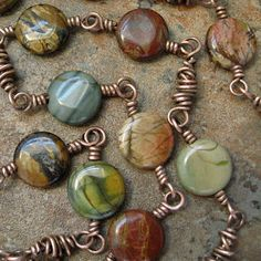 Mary Newton Jewelry love the wire work between stones