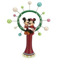 Tiny Mickey and Minnie Mouse ornaments in Christmas tree toppers