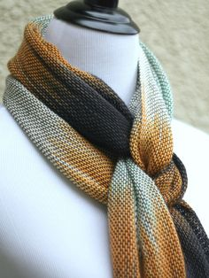 "<p>Hand woven long scarf with gradually changing colors from white to orange, black and light mint. Amazing color shades and color variety.</p> <p>Measures: <br>L: 78"" with... #kgthreads"