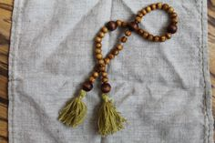 My second rosary. Wood isn´t varnished. The tassels are green silk.