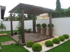 Pergola with herringbone pattern and cute landscaping.