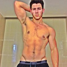 #NickJonas is no longer a little boy! Now at 20, he is showing off his pleasantly ripped physique and the ladies can't complain!