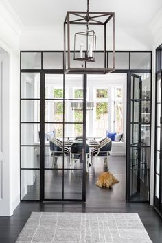 A Stylish Family Home Inspired by the Hamptons Photos   Architectural Digest The industrial French doors and Circa Lighting lantern provide a contemporary contrast to the traditionally appointed breakfast area beyond.