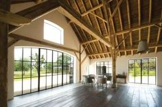 Combination of modern/warehouse type windows adjacent to rustic wood finishes