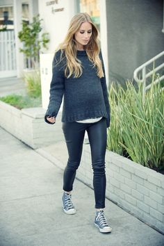 Adorable fall maternity outfit: knit sweater with leather-like leggings and high-top sneakers.