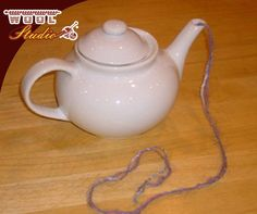 #KnittingHack: Does your yarn ball have a mind of its own, leaping from your chair or table and careening around the room like a pinball as you knit? Bags of fun for the cat, but if you want to keep that little bugger (the yarn, not the cat) in one place, try putting it in a teapot. #TheWoolStudio