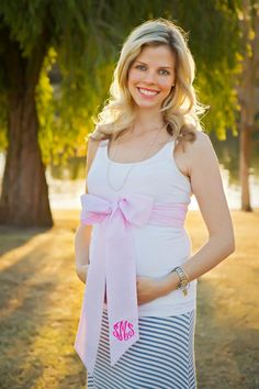 Gender reveal photo shoot with Beaufort Bonnet Co.'s maternity sash