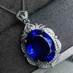 Mak_minerals. The another tanzanite pendant in 18K white gold natural diamonds around Stone specification: 17.2*13.8 Tanzanite weight: 20.6 carats