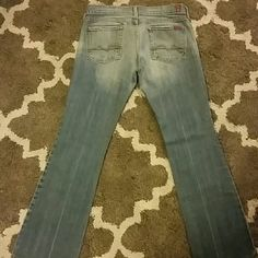 7 jeans Light blue faded wash. Authentic 7 jeans.  Size 28, 30 inches inseam. It has a smsll dark blue stain as seen in picture.  Boot cut. Low rise. 7 for all Mankind Jeans Boot Cut