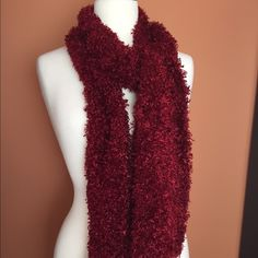 Red Polyester 65 in Long Scarf Long fuzzy 65 in scarf measuring 6 1/2 in width throughout majority of scarf and 9 in width at the ends of both sides of the scarf. Accessories Scarves & Wraps