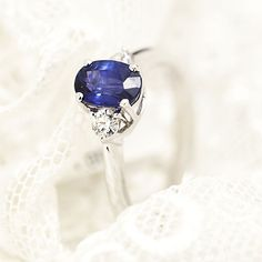 One stone blue saphire and diamonds engagement ring by Coriolan
