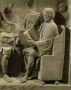 Man consulting a register. Relief (2nd-3rd CE) on a funeral stele. Detail. Rheinisches Landesmuseum, Trier, Germany