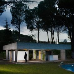 San Lucas Pavilion by FRPO is a concrete pool house amongst pine trees