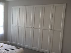 IKEA PAX wardrobes built into a stud wall. HURDAL doors painted in farrow and ball Strong White, walls in Cornforth White. Excellent little IKEA hack for our bedroom!