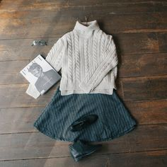 Polo neck chunky cable knit jumper & mid length flair skirt:  www.oliveclothing.com
